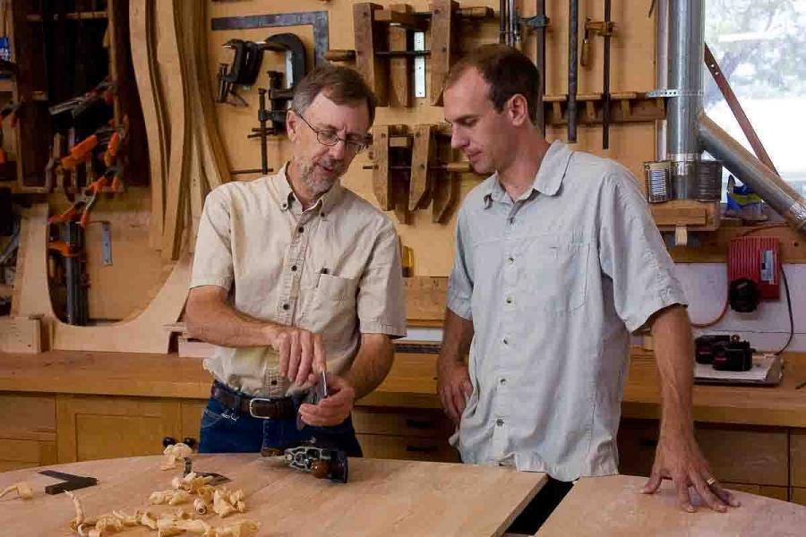 Gary and Austin adjusting plane iron