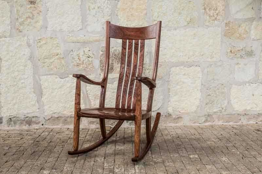 a comfortable rocking chair on bricks