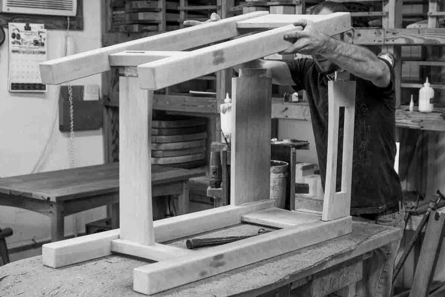 Aaron assembling standup desk