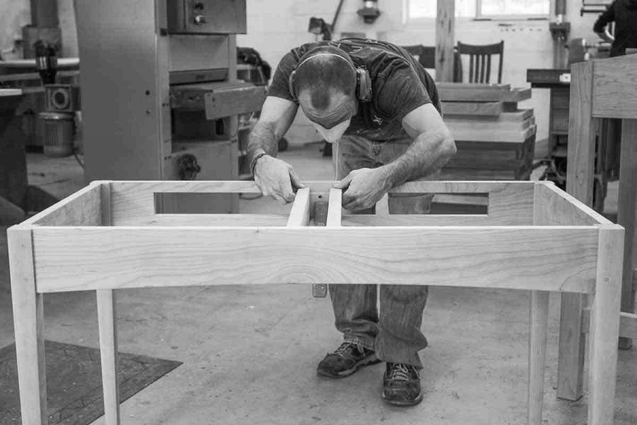 Aaron assembling a writing desk