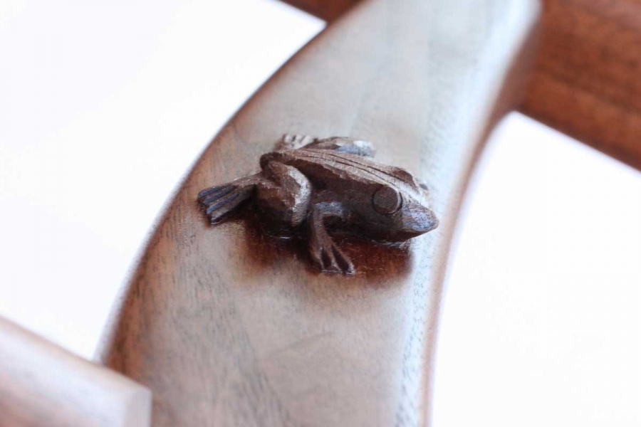 frog carved on rocking chair leg