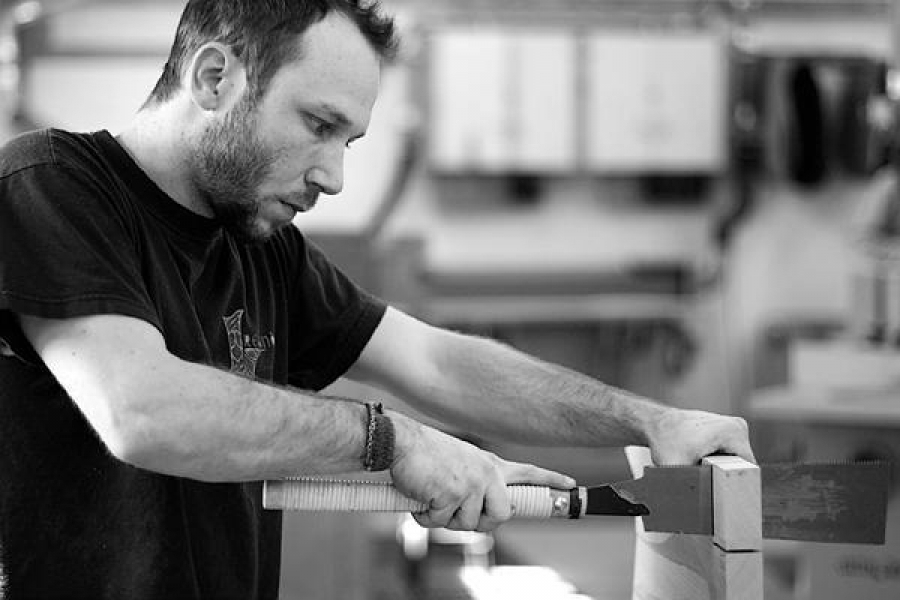 Aaron sawing through tenons flush