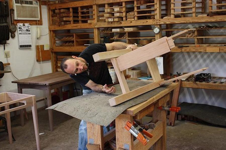 Aaron assembling a standup desk