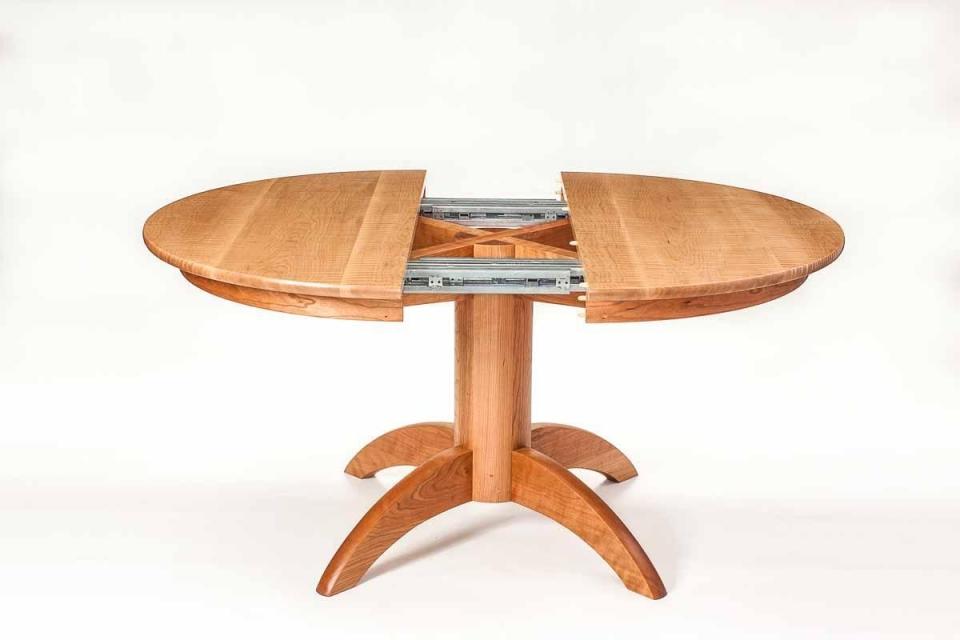pedestal extension table open for leaf