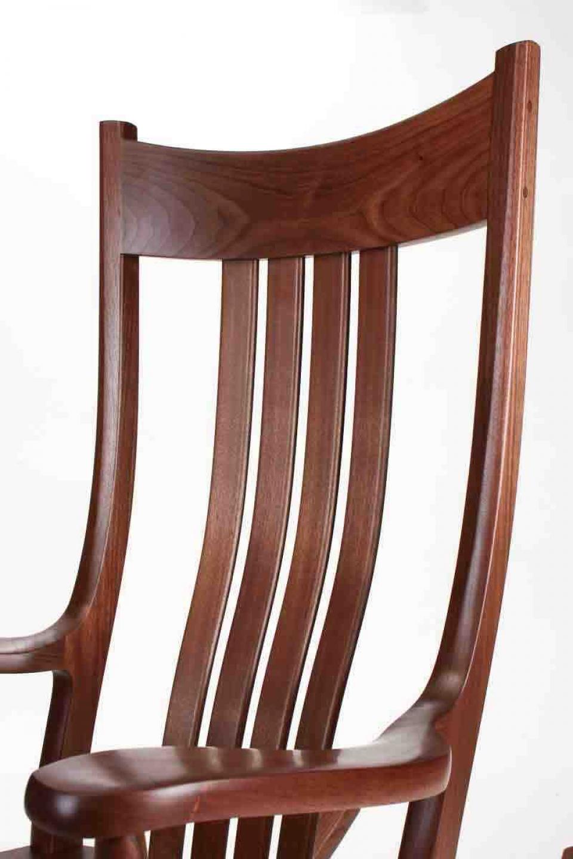 walnut rocking chair closeup of crest