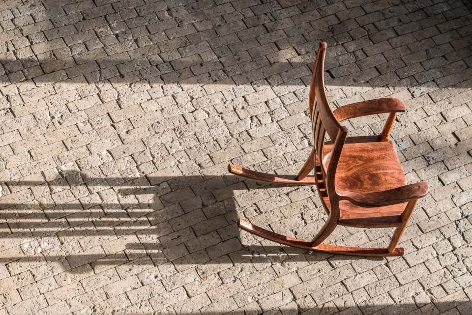 mesquite rocker on brick floor in the sun