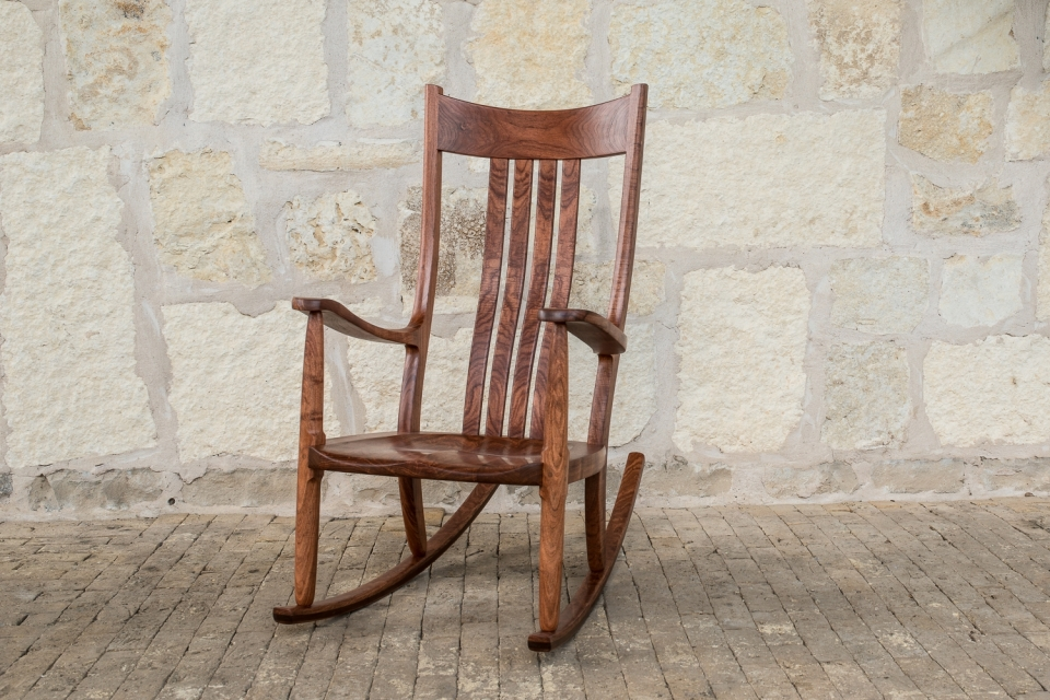 mesquite rocking chair with rock wall