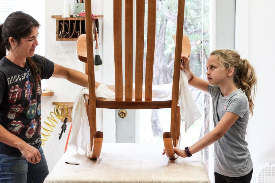 Audra and Wiley finishing a rocking chair