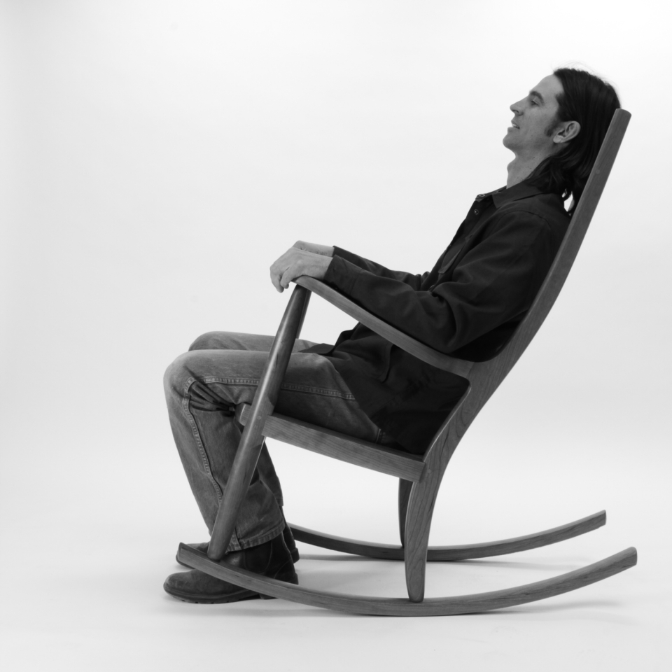 rocking chair and person, B&W 5