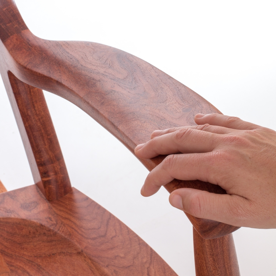 hand on rocking chair arm