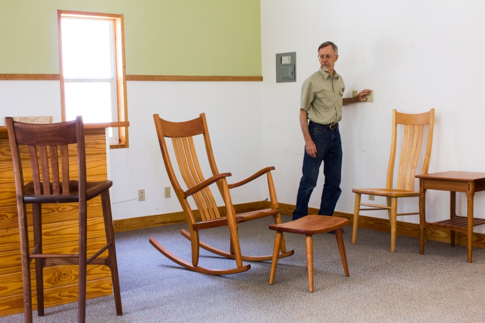 Gary in the showroom with chairs