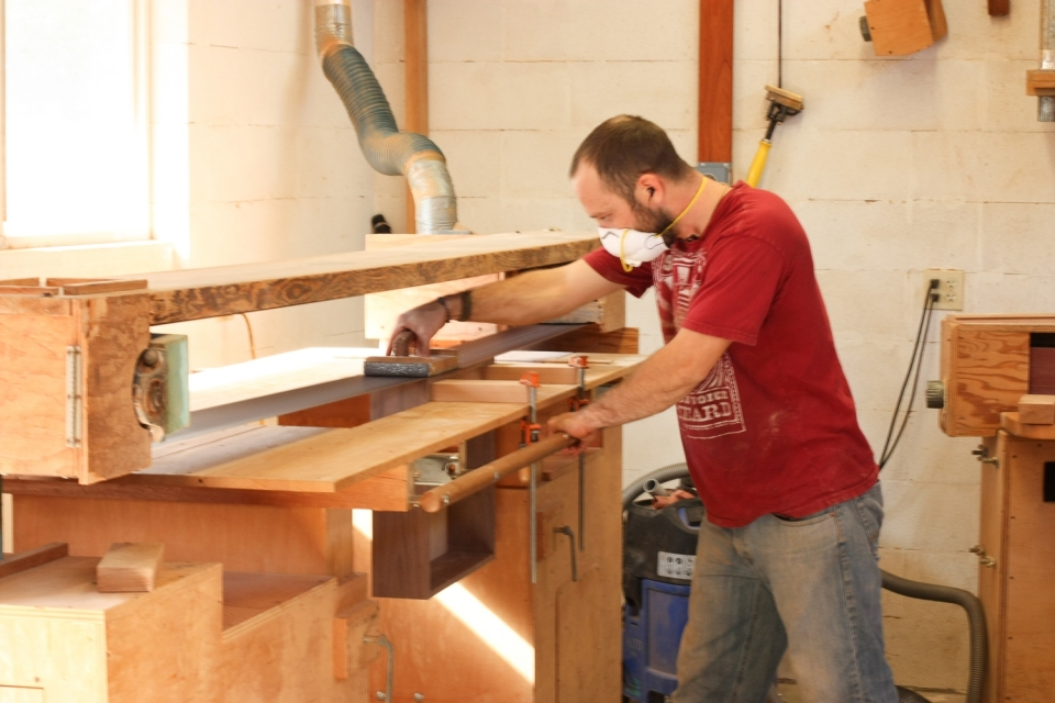 Aaron stroke sanding a drawer side to fit