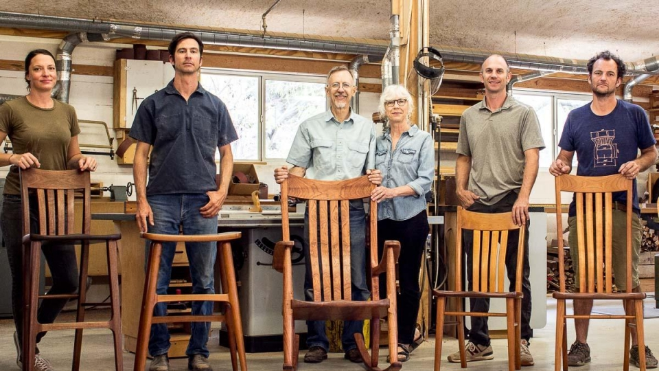 the company standing behind the furniture