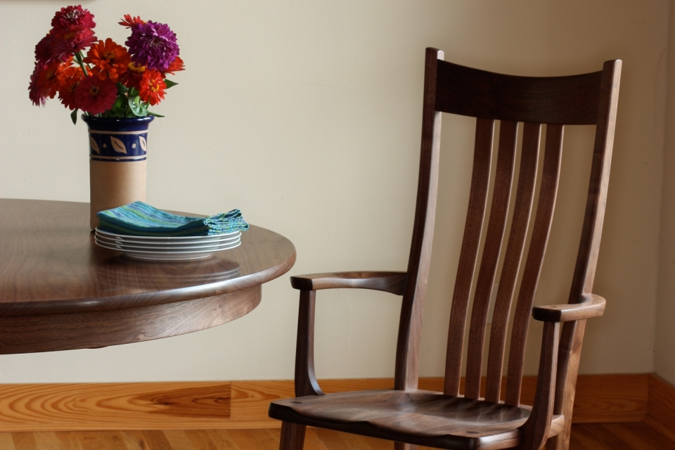 arm chair, dining table, and flowers in vase