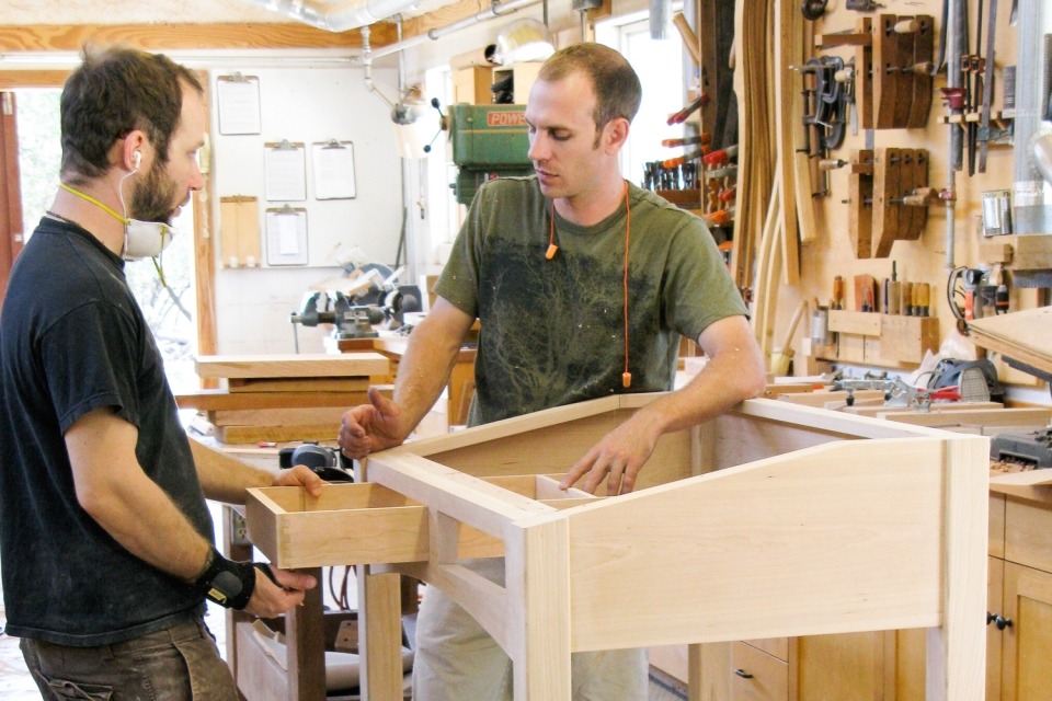Austin and Aaron fitting standup desk drawers