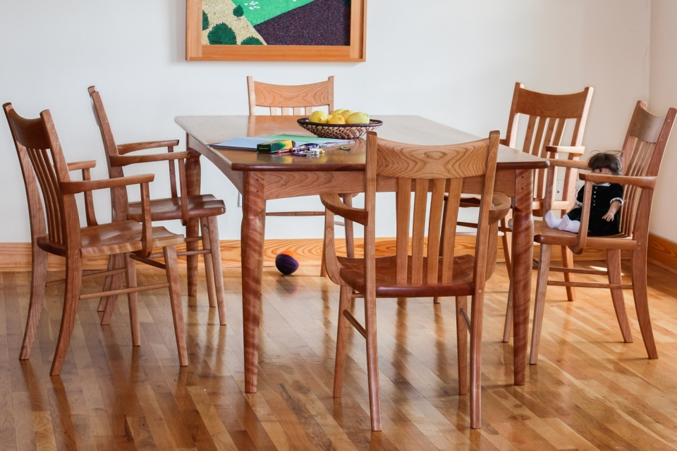 Paschall dining table and six Williams chairs in cherry in setting