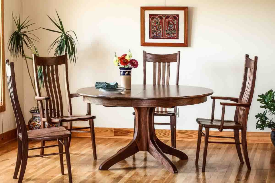 Johnson pedestal table with four chairs in setting