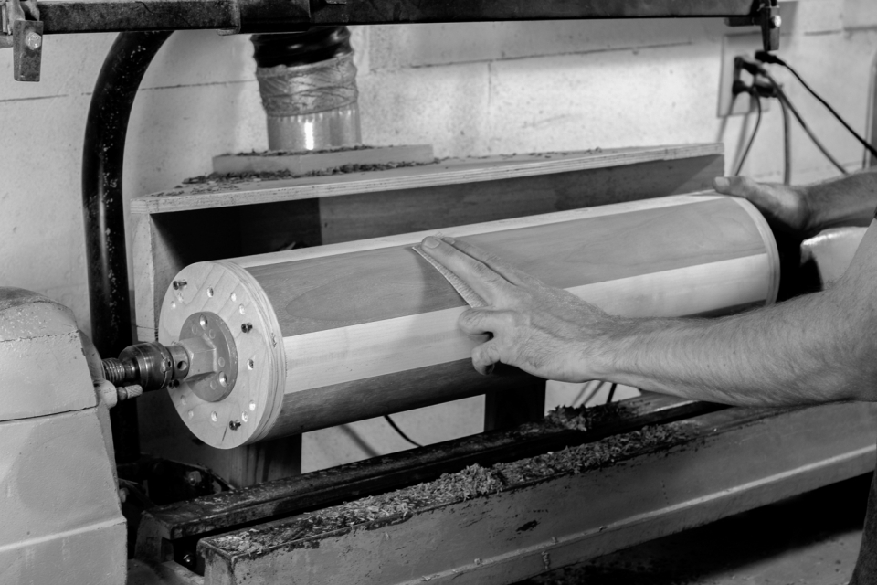 sanding base parts in a fixture on the lathe