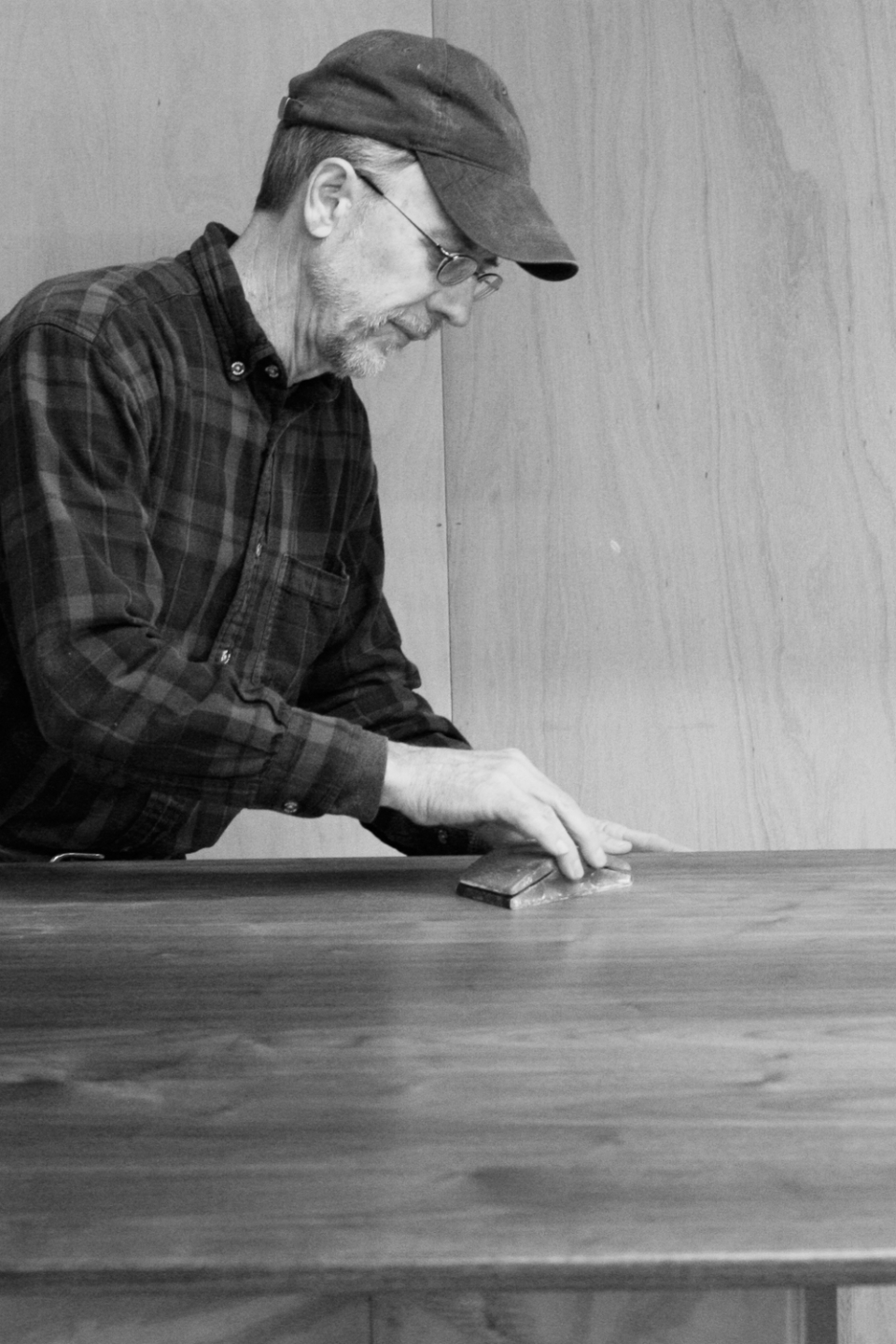 Gary sanding between coats of finish