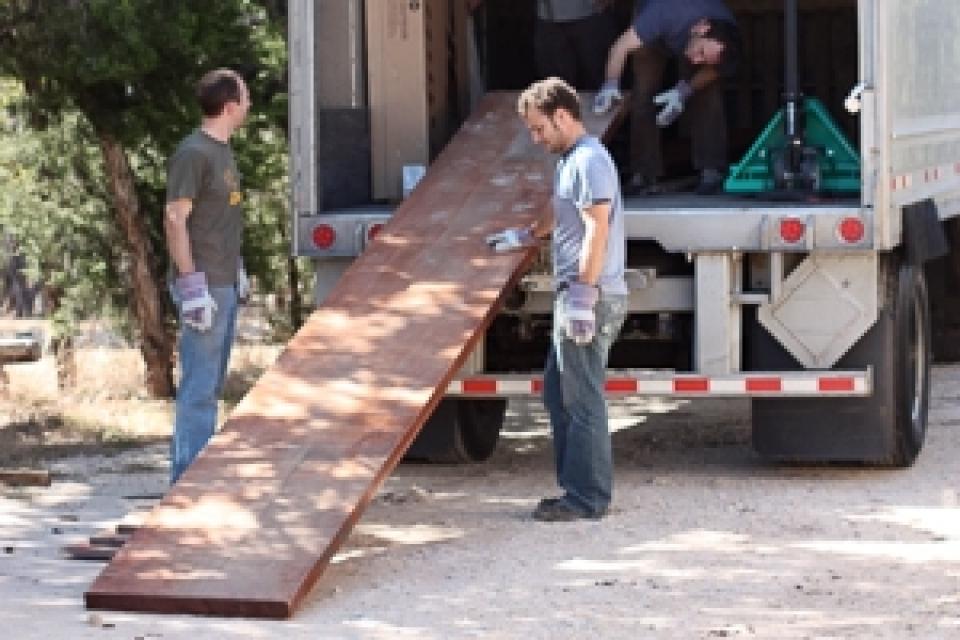 unloading mahogany for a custom trestle table