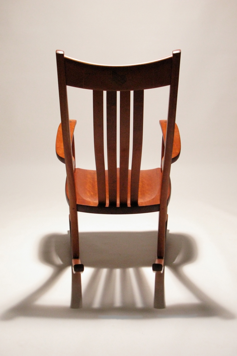 rocking chair back view, shadow