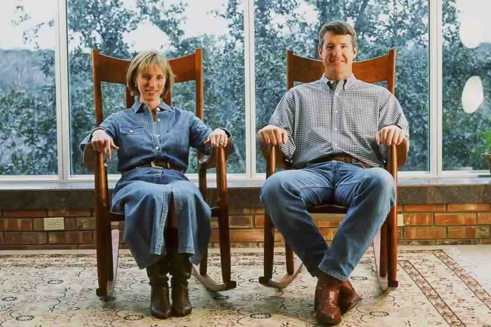 a couple, short and tall, in Weeks rocking chairs
