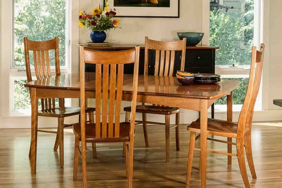 Phillips table with four Wilson chairs in setting