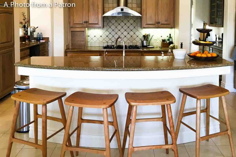 four Berry barstools at a curved counter