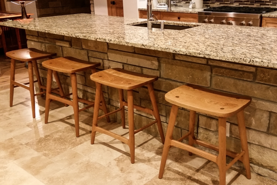 four Berry barstools at granite counter