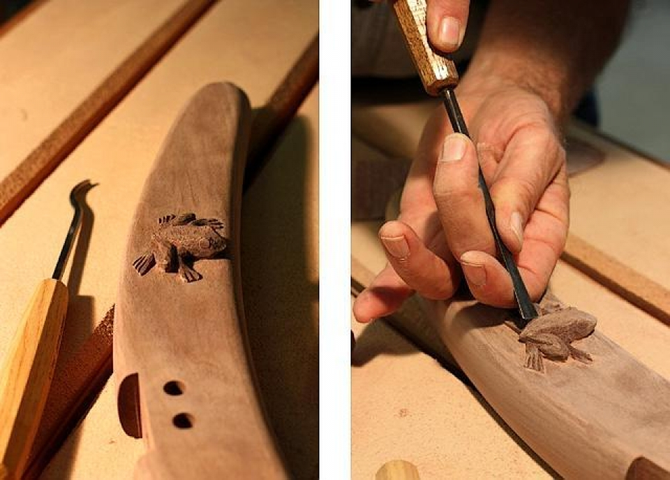 carving a frog on a rocker back leg