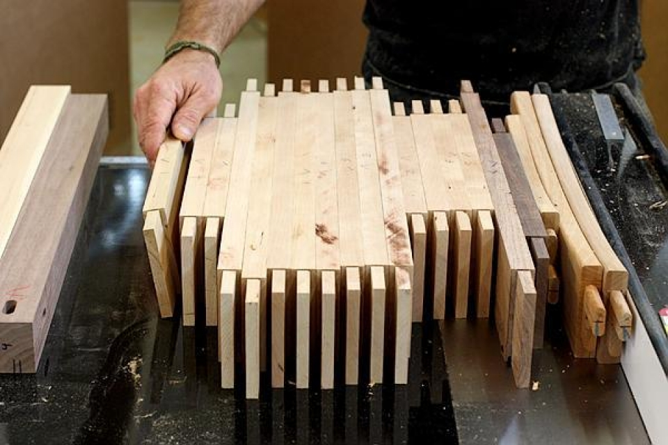 a row of rails with rough cut tenons
