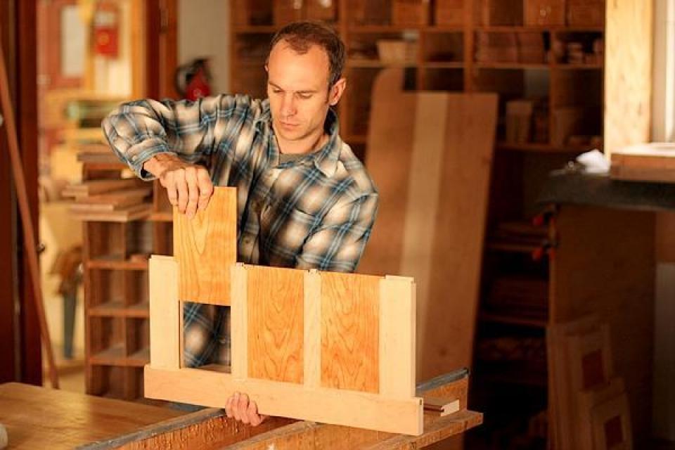 Austin assembling a desk panel