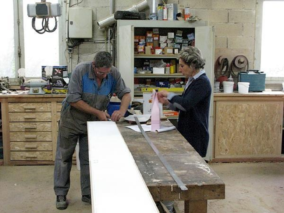 Christian and his wife at the work bench