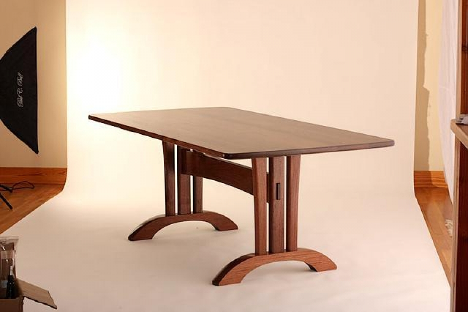 trestle table photographed on a backdrop