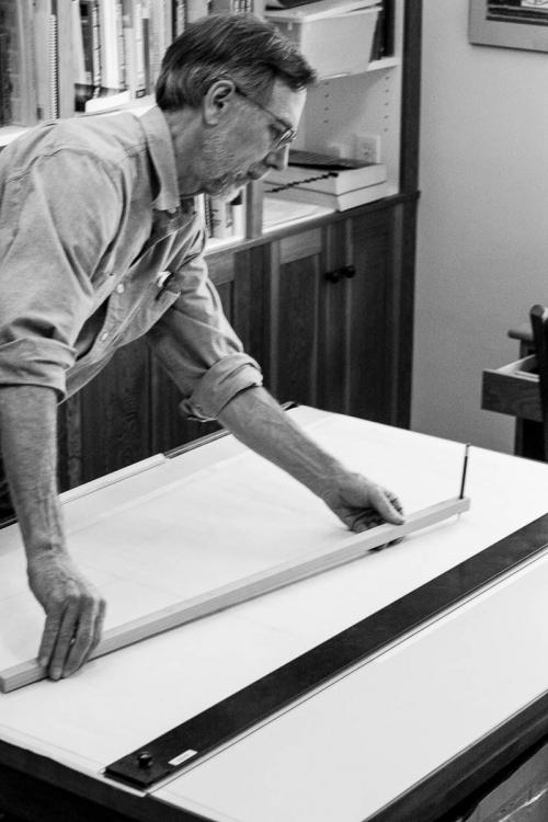 Gary scribing a large radius at the drawing board