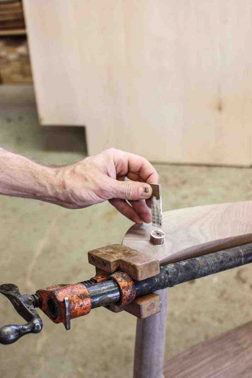 driving a wedge to secure a through tenon 1