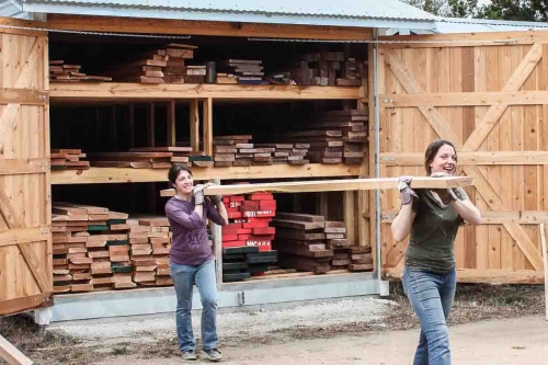 carrying lumber from shed to shop