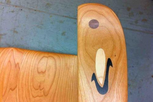 Wyffels logo inlay in chair arm