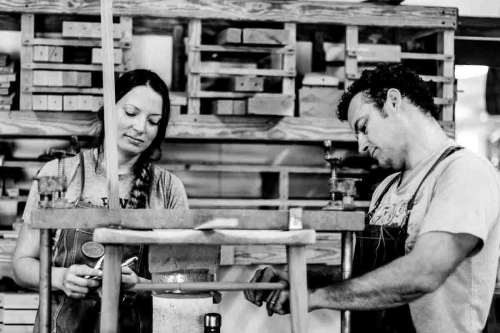 Autumn and Will assembling a dining chair