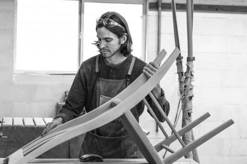 Bonner sanding a dining chair