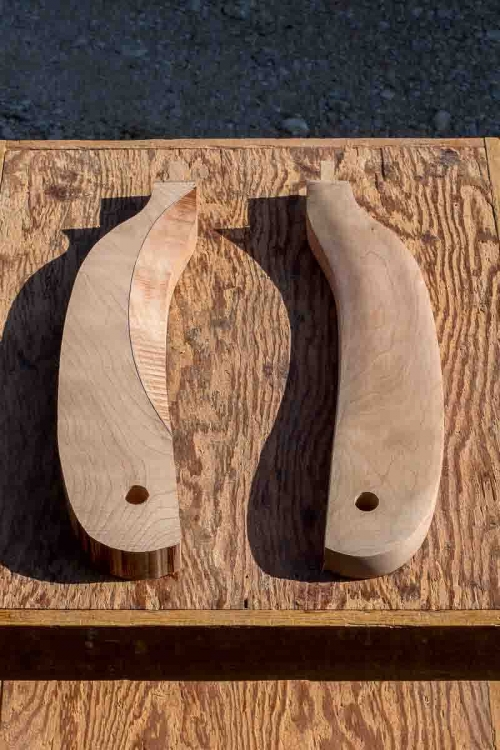 two rocking chair arms, one sawn, one sanded