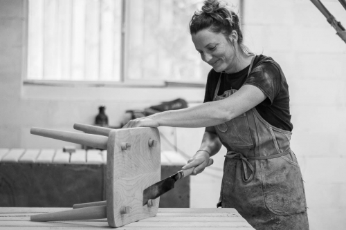 Autumn sawing through tenons on footstool top