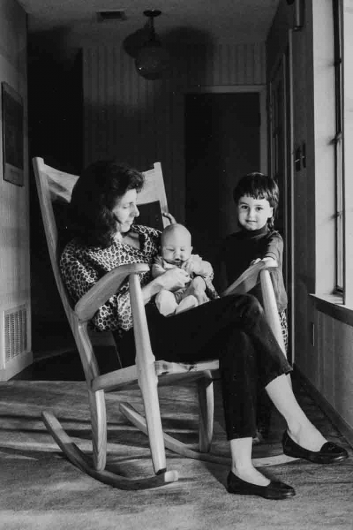 rocking chair with mother, baby, and child