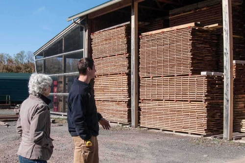 lumber stacked neatly in air drying sheds