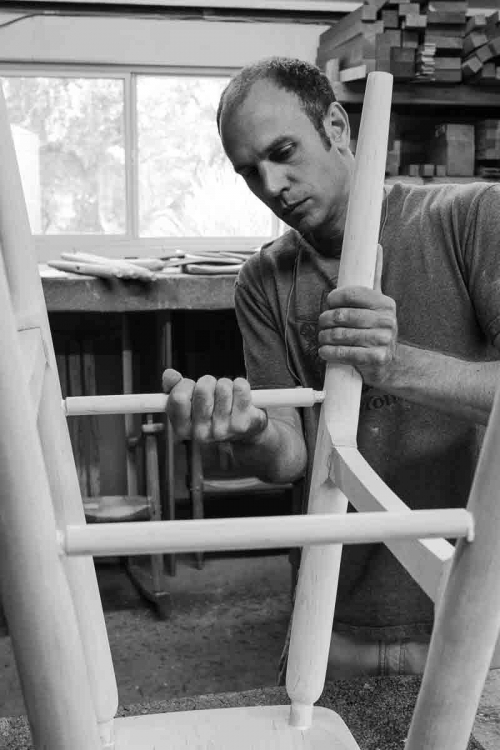 Austin gluing a barstool spindle
